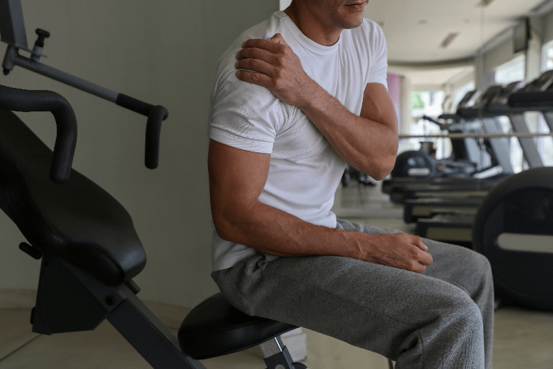 Man with shoulder pain in gym