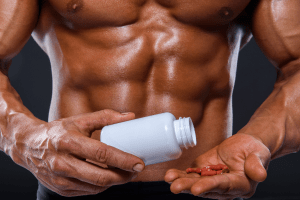 Man with 6 packs is taking multivitamins