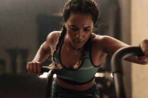 Woman doing intense workout on vertical climber