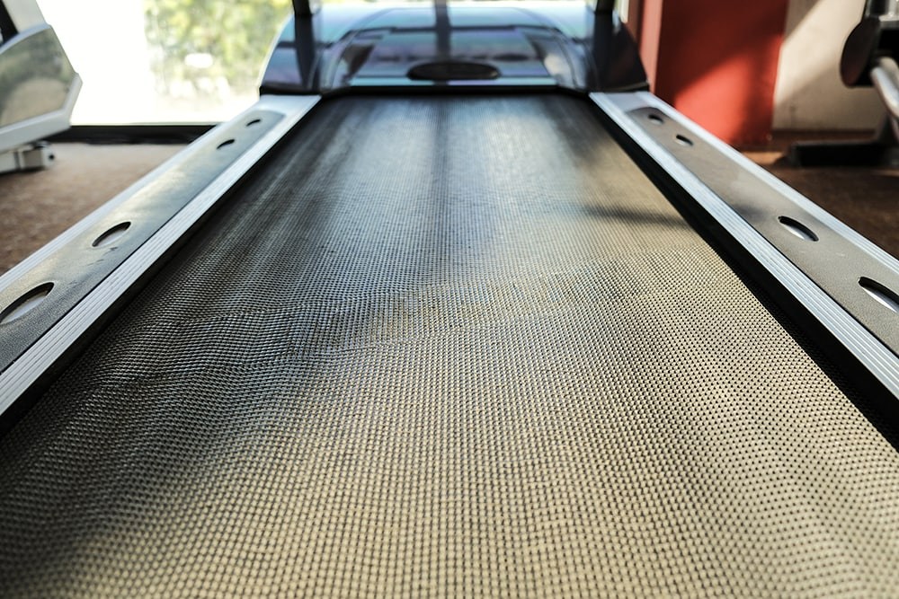 Close up select focus at rubber floor the running machine with sunlight shine