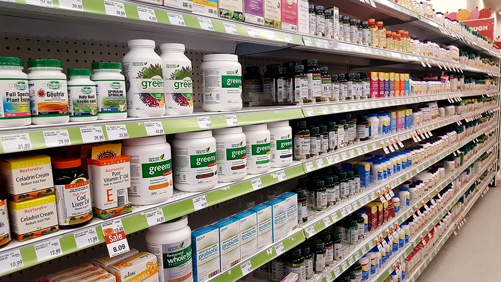 Vitamins and nutrients on sale at a supermarket shelf